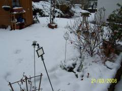 Snow covered garten with easter eggs