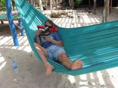Martijn relaxing on the beach in a hammock
