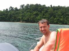 Martijn on the speedboat with Koh Rok in the background